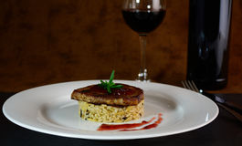 Pork medallion with risotto. Stock Photos