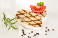 Pork medallion with tomato and parsley Royalty Free Stock Photography
