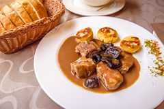 Pork medallions and dried plums Royalty Free Stock Photo