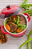 Pork medallions in herbs Stock Images