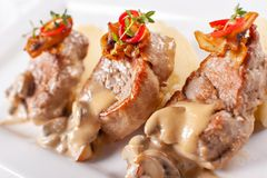 Pork Medallions with Mashed Potato and Mushrooms. Pork tenderloin on a white plate, good serving. restaurant menu. Pork Medallions with Mashed Potato and stock photos