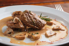 Pork medallions with mushroom sauce Royalty Free Stock Image