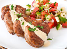 Pork medallions with salsa Royalty Free Stock Photo