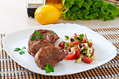 Pork medallions with salsa Royalty Free Stock Photos