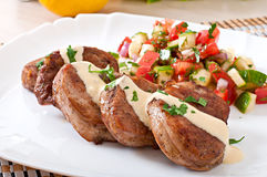 Pork medallions with salsa. On plate Stock Images