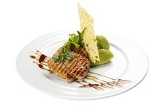 Pork medallions. Traditional Italian dish. On a white background royalty free stock photos