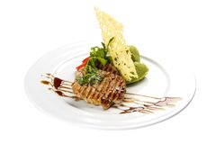 Pork medallions. Traditional Italian dish. On a white background royalty free stock photo