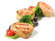 Pork medallions on vegetable cushion Royalty Free Stock Images