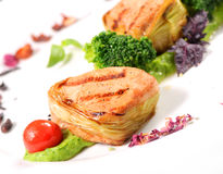 Pork medallions on vegetable cushion Royalty Free Stock Photo