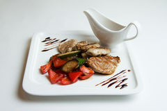 Pork Medallions. Medallions of pork with vegetables Royalty Free Stock Photos