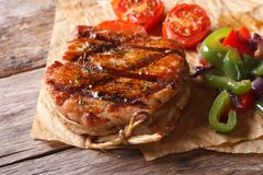 Pork medallions with vegetables closeup top view, rustic Royalty Free Stock Image