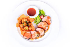 Pork medallions with young potatoes and Tabasco sauce. Food on white background with lemon Royalty Free Stock Photo