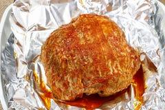 Pork in metal foil prepared for baking Stock Photo