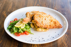 Pork Milanese with side of salad Royalty Free Stock Images