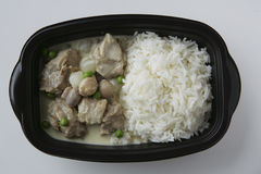 Pork, mushrooms with basmati rice in plastic dish Stock Images