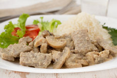 Pork with mushrooms, boiled rice Royalty Free Stock Photos