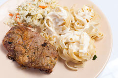 Pork neck grilled and pasta Stock Image