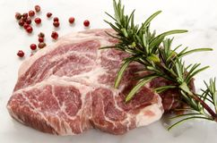 Pork neck with rosemary and red peppercorn Stock Images