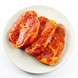 Pork neck slices on a plate Royalty Free Stock Photography