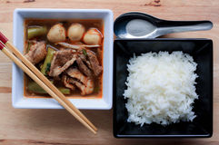Pork noodle soup served with rice on wooden tabel. Pork noodle thai soup served with rice on wooden tabel Royalty Free Stock Photos