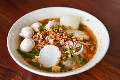 Spicy tom yum noodle with pork Stock Photo