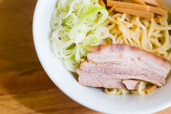 Pork and onion sliceed on noodle in red bowl Stock Photos