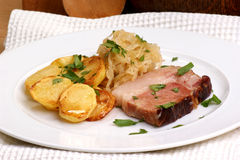 pork with organic sauerkraut and potato Stock Photos
