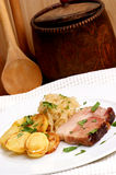 pork with organic sauerkraut and potato Royalty Free Stock Image