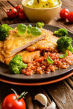 Pork Piccata with tomato sauce and steamed broccoli and boiled potatoes royalty free stock photo