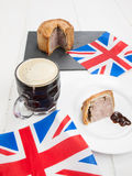 Pork pie and beer with flags Royalty Free Stock Photo