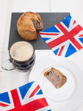 Pork pie and beer with flags Royalty Free Stock Image