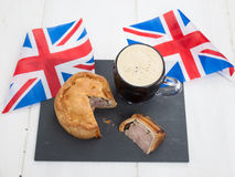 Pork pie and beer with flags Royalty Free Stock Images