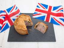 Pork pie with british flags Royalty Free Stock Photography
