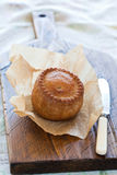 Pork pie on a chopping baord Royalty Free Stock Photography