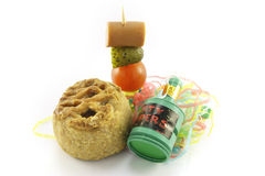 Pork Pie with Cocktail Stick and Party Popper Stock Images