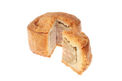 Pork pie isolated. Pork pie with a section cut out isolated against white Royalty Free Stock Photography