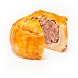 Pork pie isolated on a white studio background. Royalty Free Stock Images