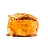 Pork pie isolated on a white studio background. Royalty Free Stock Photography