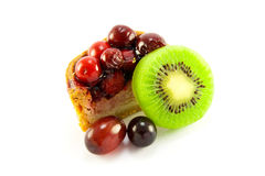 Pork Pie with Kiwi and Grapes. Slice of pork pie with kiwi and grapes with clipping path on a white background Stock Images