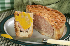 Pork pie and mustard Stock Photos