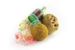 Pork Pie and Scotch Egg with Party Popper. Small tasty pork pie, small round scotch egg and streamers with party popper on a reflective white background Royalty Free Stock Photo