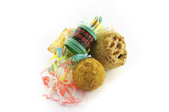 Pork Pie and Scotch Egg with Party Popper. Small tasty pork pie, small round scotch egg and streamers with party popper on a reflective white background Royalty Free Stock Photography