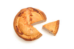Pork Pie and slice. Photograph of a pork pie shot in studio overhead and isolated on a white background Stock Images