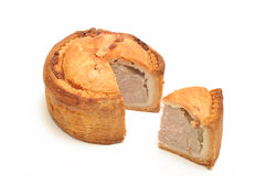 Pork Pie and slice. Photograph of a pork pie shot in studio and isolated on a white background Royalty Free Stock Photo