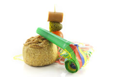 Pork Pie With Cocktail Stick And Party Blower Stock Photo