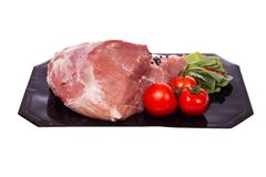 Pork. piece. Fresh meat with vegetables on white background. Studio photography Stock Photo