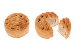 Pork pies. Whole and portioned lattice topped pork pie isolated against white Royalty Free Stock Photography