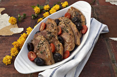 Pork with plums and tomatoes Royalty Free Stock Photos