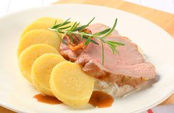 Pork with potato dumplings and white cabbage Royalty Free Stock Photo
