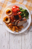Pork with potatoes, vegetables and Yorkshire pudding vertical to Royalty Free Stock Photography
